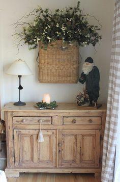 52 FLEA: A Tour of Evi's Christmas Cottage-Large basket w/greenery on wall