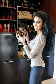 Lilly Ghalichi shows off her collection of #RedBottoms. Great idea for displaying shoes!