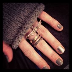Gray. One is a metallic gray. I like the jewelry too. That bird goes across two fingers.