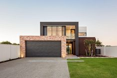 The richly textured surface of this kiln-fired Italian brick creates an eye-catching rustic exterior to a modern waterside home. Brick Cladding, Brick Facade, Facade House, Modern Brick House, Modern House Design, Modern House Facades, Modern Exterior, Exterior Design, Rustic Exterior