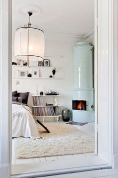 inspired palettes - mint colored scandinavian fireplace