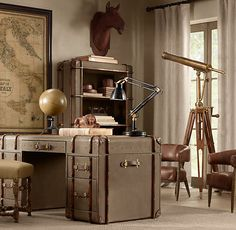 Only Restoration Hardware could make me think my apartment is incomplete without a decorative telescope.