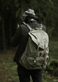 Backpack, jacket, beanie.