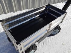 This All-Terrain Electric Cart is equipped with aluminum removable sides to keep the payload secure. Standard features are black color and SuperLug tires. Electric Utility, Pug, Cart, Platform, Trucks, Color, Black, Covered Wagon, Black People