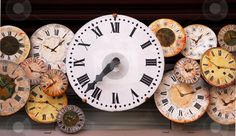 Antique clock faces each with it's own personality