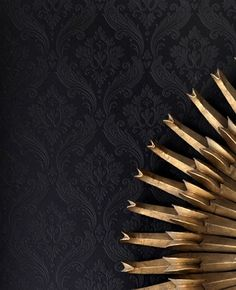 Love the subtle detail in this wall paper.  The gold sunburst is nice contrast too :)