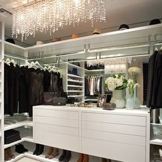 This is one of my favorite closets: mirrored backs to make closet feel bigger, L-shape corner shelves to maximize & chandelier! I love the energy & interaction, guys! Keep asking and use #dearclosetguru