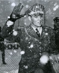 Elvis Presley.  Love this photo of him in uniform, snow really coming down & showing up as huge blotchy flakes. Still magical somehow.