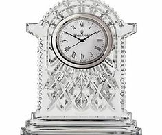 Waterford Crystal Lismore Carriage Clock, Large An elegant addition to any mantle or desk, the Lismore clock features an elegant cream clockface with Roman numerals and brass finish. Its sweeping frame of fine, handcrafted crystal is intricately de http://www.comparestoreprices.co.uk/home-accessories/waterford-crystal-lismore-carriage-clock-large.asp