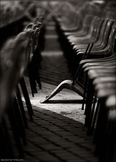 Idea:  breaking free from uniformity...all in order then one thrown out of place..not even in order/place/line...just completely separate...obvious...remove the chair from the row and throw it someplace as more of a rebellious touch...stronger feeling/emotion applied