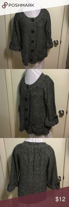 "Carolyn Taylor Cardigan Dark gray marled cardigan size small. Buttons up the front with button detail on sleeves. Sleeves are 3/4 or bracelet length. Has 2 pockets in the front. Acrylic knit with no pilling. In great condition. Measurements: armpit to armpit 17"", sleeves 17"",length 24"". Carolyn Taylor Sweaters Cardigans"