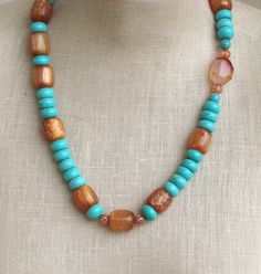 Turquoise Coral  Vintage Beads Coraline Milagro silver clasp orange necklace. $40.00, via Etsy.