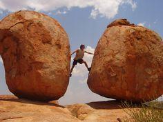 Tony climbing the Devil's Marbles, Australia