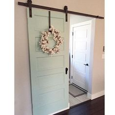 The #decorsteals cotton wreath looks amazing against this sliding barn door!!  thank you for sharing @emily_k_burke ❤️ #vintageinspired #vintagefarmhouse