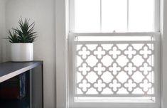 Much nicer than security bars - a strip of dedorative steel lattice in a frame - via Hindsvik Blog
