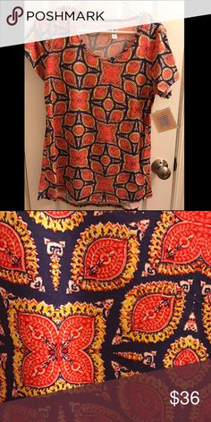 BNWT LuLaRoe Classic T BNWT LuLaRoe Classic T, size small, dark purple background, coral and yellow accents. LuLaRoe Tops