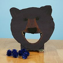 Feed the Bear.  In this simple game, children take turns feeding the bear blueberries.  (blue pom poms)  Really cute homemade game!