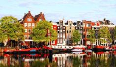 The city of Amsterdam can be seen in this picture. It shows some typical Dutch buildings and one of the canals that Amsterdam is famous for. Oh The Places You'll Go, Places To Travel, Travel Destinations, Places To Visit, Dream Vacations, Vacation Spots, Wonderful Places, Beautiful Places, Visit Amsterdam