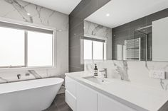 The same veined calacutta splashback above the vanity is used as the feature wall behind the bathtub, bringing cohesion to this large bathroom. Large Bathrooms, Butler Pantry, Splashback, Cabinet Design, Cabinets, Custom Design, New Homes, Bathtub, Vanity