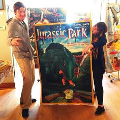 Heidi & Greg posing with the ultra beloved Jurassic Park Ghanaian handpainted movie poster by the artist Stoger! Our next exhibition is opening Saturday Oct. 24. 5-10pm. In honor of the holiday we'll feature American horror film posters originally handpainted in Ghana! 1433 W. Chicago Ave. Questions on pricing etc? Call 312.659.1991 or brian@deadlypreygallery.com. #ghanamovieposters #deadlypreygallery #movies #africanart #artshow #artforsale #horror #art #movieposter #artcollector #design…