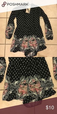 Romper NWOT! Super cute long-sleeve romper with a tie at the neck. Very lightweight so you don't get hot even though the sleeves are long. Floral / paisley print. Xhilaration Dresses