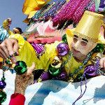 #MardiGras float rider passing out some big beads! #NewOrleans