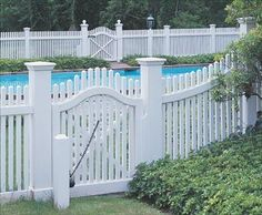 """Chestnut Hill Picket Fence - """"Sturdy, square pickets with subtle pointed tops define this charming, highly popular fence. The 7"""" square posts shown here support a scallop top gate that features ball-and-chain hardware. The rails, fascia and kick board are routered. Mortise and Tenon installation."""""""