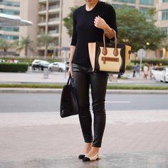 """All black for a working weekend. chanel slingbacks, thekooples leather pants, celine luggage tote, zara sweater"" dubai streetstyle Yasmin_dxb instagram"