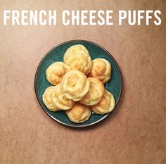 """Say bonjour to your new favorite cheesy bread recipe! These French Cheese Puffs (or """"gougères"""" to the gourmet) are light and flaky, deliciously savory, and surprisingly easy to make. Mix together a few simple ingredients - butter, flour, eggs, water, and Gruyere cheese - and then use our freezer bag hack to pipe them onto a baking tray just like a true pastry chef. Voila!"""