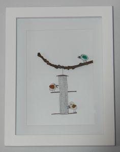 Seaham Sea Glass birds on a bird feeder.