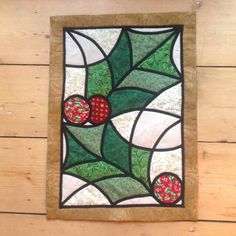 Stained glass patchwork holly wall hanging. Pattern by Gail Lawther. Christmas gift for Mum.