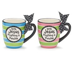 Hand-painted ceramic mug with decal message and black with white polka dot ribbon tied to the