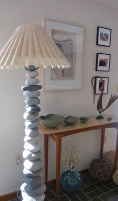 Stone Lamp ~ This is just beautiful to me. I doubt i would have that much patience for drilling the rocks though.