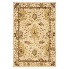 """Stylishly anchor your dining set or living room seating group with this hand-tufted wool rug, showcasing a Persian-inspired motif on an ivory background.   Product: RugConstruction Material: WoolColor: Cream and redFeatures:  Hand-tuftedCotton backingDense pile Pile Height: 0.63""""Note: Please be aware that actual colors may vary from those shown on your screen. Accent rugs may also not show the entire pattern that the corresponding area rugs have.Cleaning and Care: Vacuum regularly. Avoid ..."""