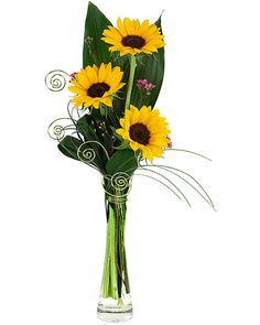 SUNFLOWER TRIO: Seasonal sunflowers are florist-arranged in a stylish bud-vase with greenery and added creative touches