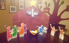 Nativity scene made from hand & footprint art on foam board. I cut little squares with notches & matching notches on the people & animals so they would stand up. Great group project or just some fun with your kids!