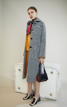 The designer: It's the hotly anticipated first collection under new creative lead Francesco Risso, who joined from Prada.  This season it's about: A quirky elegance perfectly attuned with the Marni DNA—and a plethora of to-die-for coats (including the new Stutterheim collaboration).