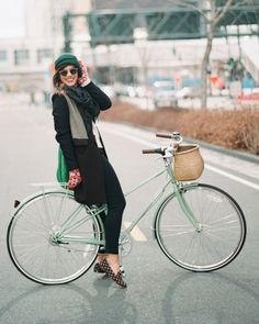 The touches of green bring her whole look together