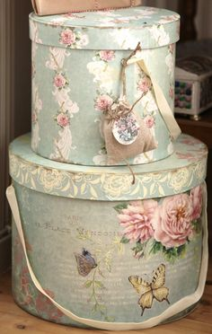 Change simple cardboard boxes into something special with vintage wallpaper (or new paper) add decorative images or a ribbon maybe.