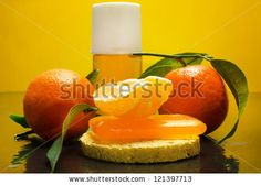clementine spa treatment over yellow background - stock photo