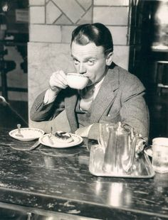 In the days before air travel became popular, almost everyone took the train to get around the United States.  On February 6, 1945 before boarding the Twentieth Century Limited for Chicago, James Cagney stopped in at a restaurant at Grand Central Terminal for a bite to eat. It appears he was enjoying a cup of coffee and a danish. Then he glanced up to see a photographer snapping this picture.