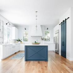 Blue and white kitchen featuring a blue island with x trim and glass globe pendants. Blue Kitchen Island, Blue Kitchen Cabinets, Painted Kitchen Island, Kitchen Islands, Kitchen Island Different Colour, Tabarka, Organizing Hacks, Barn Kitchen, White Shiplap