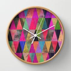 I'm inspired - use a embroidery hoop instead with fabric rather than paper. Would need some stability for clock parts though.