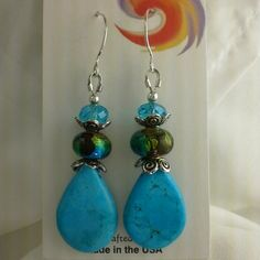 ★STERLING SILVER!★Genuine Turquoise Drop Earrings Sterling silver earwires with genuine, stabilized turqouise teardrop beads, silver foiled lampwork beads, and authentic Swarovski crystals!   Great colors for fall!  Handcrafted- one of a kind!  Discount with bundle!  Necklace no longer available LesliesBox Jewelry Earrings