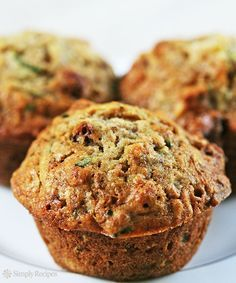 The BEST zucchini bread muffins EVER Moist sweet packed with shredded zucchini walnuts dried cranberries and spiced with vanilla cinnamon and nutmeg On Zucchini Bread Muffins, Best Zucchini Bread, Zucchini Muffin Recipes, Healthy Muffins, Chocolate Zucchini Muffins, Shredded Zucchini Recipes, Zuchinni Recipes Bread, Best Zucchini Recipes, Zucchini Cake