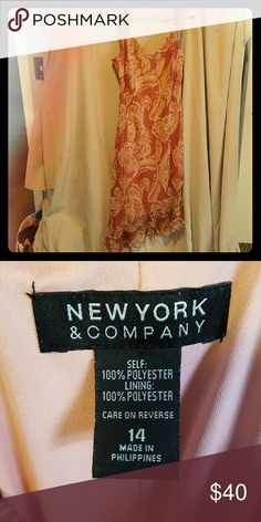 Mauve and cream paisley dress This is a sheer material overlaying a soft pink spandex material. Waterfall with soft ruffles on the left side. Looks brand new, worn twice. The pictures do it no justice. New York & Company Dresses High Low