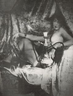unknown model circa1890s with a hooka or water pipe possibly meant to be an image of an opium den #history
