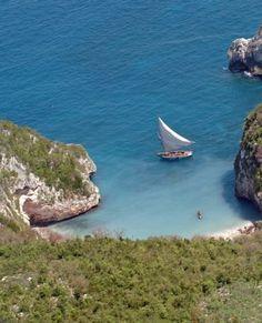Fishing boat along the rocky coastline of Jeremie, Haiti
