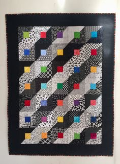 This is a stunning king sized quilt made from the fabric range called Shades of Black by Me and My Sister Designs for Moda. Modern patchwork quilt, throw in Cotton and Steel fabrics and white Moda… Flannel Quilts, Lap Quilts, Strip Quilts, Scrappy Quilts, Small Quilts, Mini Quilts, Quilting, Scrappy Quilt Patterns, Jelly Roll Quilt Patterns