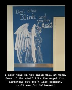 I drew this on the chalk wall at work.  Some like the christmas angel but dont understand the comment. ...it was for Halloween.